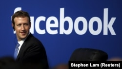 FILE - Facebook CEO and founder Mark Zuckerberg, shown in 2015, dismisses the notion that fake news stories on the social media network swayed U.S. election results.