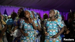 Some of the girls who were kidnapped by Boko Haram militants in the Nigerian town of Chibok, are seen dancing joyfully during the the send-forth dinner organised for them in Abuja, Nigeria.