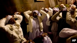 Christian pilgrims from Nigeria pray inside the Grotto of the Church of the Nativity, traditionally believed by Christians to be the birthplace of Jesus Christ, in the West Bank city of Bethlehem on Christmas Eve, Dec. 24, 2014.