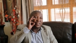 Thamsanqa Jantjie gestures at his home during an interview with AP in Johannesburg, Dec. 12, 2013.