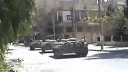 آسوشیتد پرس - تانکهای ارتش سوریه برای سرکوب تظاهرکننندگان - ۱۳ اوت ۲۰۱۱