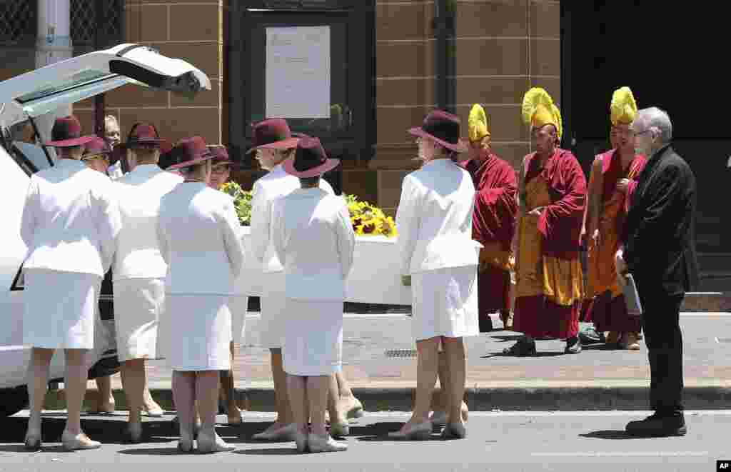 Pallbearers move the coffin of Tori Johnson into a hearse during the funeral service in Sydney, Australia,  Dec. 23, 2014.