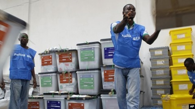 Staff organize ballot boxes from polling stations in Monrovia, Liberia, Oct. 12, 2011.