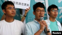 Newly elected lawmaker Nathan Law (C), student leaders Joshua Wong (R) and Alex Chow meet journalists outside a court before a hearing as prosecutors asked them to be jailed immediately over their roles in storming government headquarters in 2014 which led to Occupy Central pro-democracy movement, in Hong Kong, China September 21, 2016.