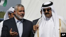 Emir of Qatar Sheikh Hamad bin Khalifa al-Thani, right, and Gaza's Hamas prime minister Ismail Haniyeh, left, during Emir's visit to Gaza Oct. 23, 2012.