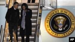 Tổng thống Obama và Ðệ nhất phu nhân Michelle Obama tại Sân bay Quốc tế O'Hare ở Chicago, ngày 6/11/2012.