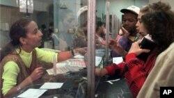 Cuban postal worker Jackeline Morera attends a line of people buying stamps at a Vedado neighborhood post office in Havana, Cuba. (file)
