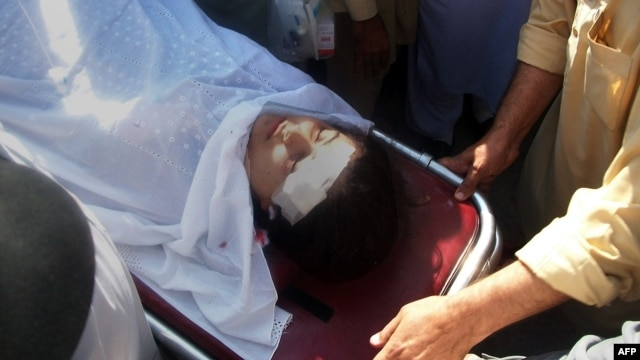 Pakistani hospital workers carry injured Malala Yousafzai, 14, on a stretcher at a hospital following an attack by gunmen in Mingora on October 9, 2012.