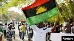 FILE - A supporter of Indigenous People of Biafra (IPOB) leader Nnamdi Kanu holds a Biafra flag during a rally in support of Kanu in Abuja, Nigeria, Dec. 1, 2015