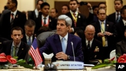 U.S. Secretary of State John Kerry listens at the East Asia Summit Foreign Ministers' Meeting in Kuala Lumpur, Malaysia, August 6, 2015.