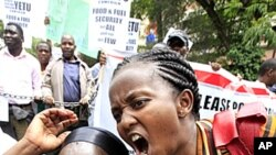 Members of Kenya's civil society chant slogans during a demonstration outside the Parliament Buildings in Nairobi, April 19, 2011