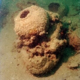 Submerged underwater for centuries, this storage jar from the Tang treasures eventually became an integral part of a coral formation.
