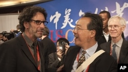 "American film director Joel Coen, left, chats with French-born American cellist Ma Yo-Yo after the opening of a forum on ""the U.S.-China arts and culture"" at National Center for the Performing Arts in Beijing, China, November 17, 2011."