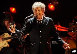 FILE - In this Jan. 12, 2012, file photo, Bob Dylan performs in Los Angeles.