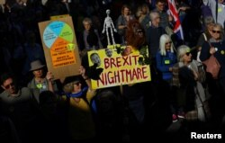 FILE - Protesters participate in an anti-Brexit demonstration march through central London, Britain Oct. 20, 2018.