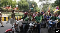 Tibetan exiles take out a protest against the 2010 Asian Games being held in Guangzhou, China in New Delhi, India, Monday, Nov.15, 2010. (AP Photo/ Mustafa Quraishi)