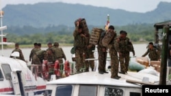 FILE - Myanmar soldiers arrive at Buthidaung jetty after Arakan Rohingya Salvation Army (ARSA) attacks at Buthidaung, Myanmar, Aug. 29, 2017.