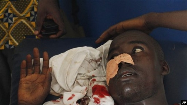 A man who says he was shot in the face by security forces loyal to Laurent Gbagbo while walking home in the Abobo neighborhood waits to receive stitches at a health clinic in the Anyama suburb of Abidjan, Ivory Coast, March 12, 2011