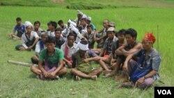 FILE - People gather near mass grave sites near Yebawkya village, Kamaungseik Township in Maungdaw District, Northern Rakhine State, Sept. 27, 2017. (Moe Zaw and Sithu Naing/VOA Burmese)