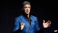 """FILE - Sylvester Stallone introduces a clip from the film """"Creed"""" at the Warner Bros. presentation during CinemaCon 2015 at Caesars Palace in Las Vegas, April 21, 2015."""