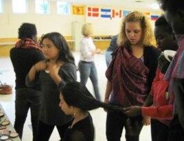 Members of the Pihcintu Multicultural Children's Chorus primp before practice.