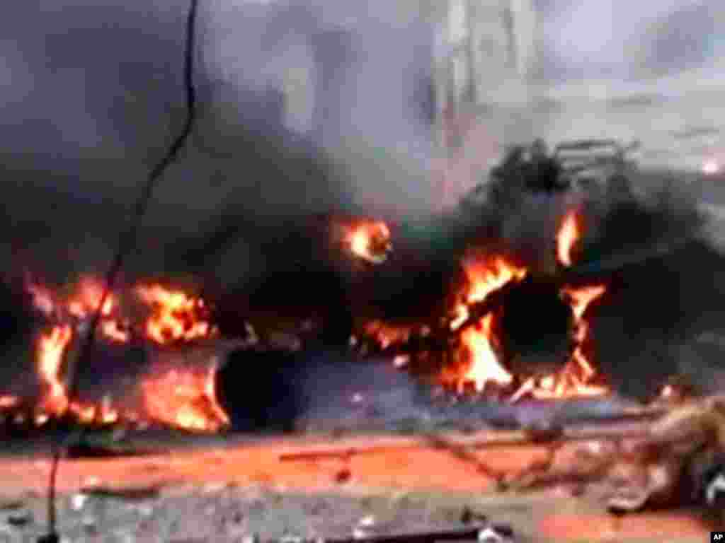 A tank is seen burning in the Syrian city of Homs, purportedly after being attacked by insurgents from the Free Syrian Army, in this still image taken from video on a social media website posted January 12, 2012. (Reuters)