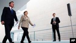 Britanski premijer Dejvid Kameron i nemačka kancelarka Angela Merkel tokom susreta u Berlinu