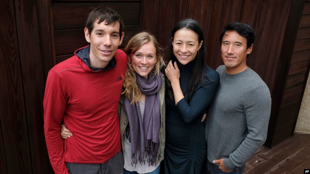 "FILE - Alex Honnold, from left, and Sanni McCandless, subjects of the documentary film ""Free Solo,"" pose with co-directors Elizabeth Chai Vasarhelyi and Jimmy Chin at the InterContinental Hotel during the Toronto International Film Festival in Toronto, Sept. 10, 2018."