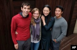 "FILE - Alex Honnold, from left, and Sanni McCandless, subjects of the documentary film ""Free Solo,"" pose with co-directors Elizabeth Chai Vasarhelyi and Jimmy Chin at the InterContinental Hotel during the Toronto International Film Festival in Toronto."