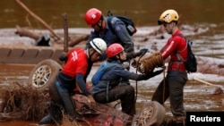 Members of a rescue team search for victims of a collapsed tailings dam owned by Brazilian mining company Vale S.A. in a vehicle on Paraopeba River, in Brumadinho, Brazil, Feb. 5, 2019.