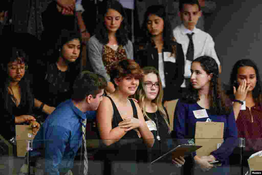 Students from Marjory Stoneman Douglas High School and those supporting them react as they watch the Florida House of Representatives vote down a procedural move to take a bill banning assault weapons out of committee and bring it to the floor for a vote in Tallahassee, Florida, following last week's mass shooting on their campus, Feb. 20, 2018.