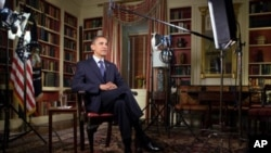 US President Barack Obama records the weekly address