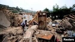 Klizišta nakon zemljotresa u Kini otežavaju spasilačka nastojanja, 23. juli 2013.