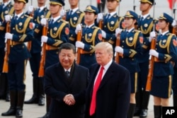 U.S. President Donald Trump, right, shakes hands with Chinese President Xi Jinping during a welcome ceremony at the Great Hall of the People in Beijing, Nov. 9, 2017.