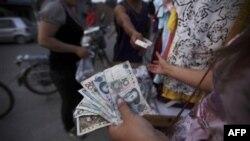 Những người vay tiền ở Trung Quốc nay sẽ phải thêm ít nhất là 0,25 phần trăm cho lãi suất tính vào số tiền vay của ngân hàng