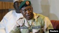 FILE - Director of Defense Information, Major General Chris Olukolade addresses the media in Abuja, Nigeria, May 2014.