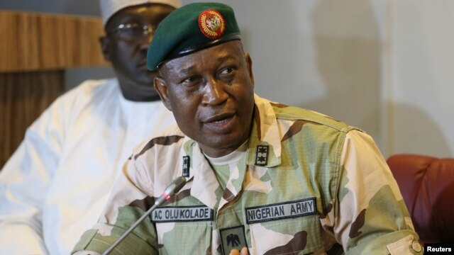 FILE - Director of Defense Information, Major General Chris Olukolade addresses the media in Abuja, Nigeria, May 2014.