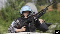 UN forces patrol outside the UN headquarters in Ivory Coast, Abidjan, Ivory Coast, Tuesday, Dec. 21, 2010.