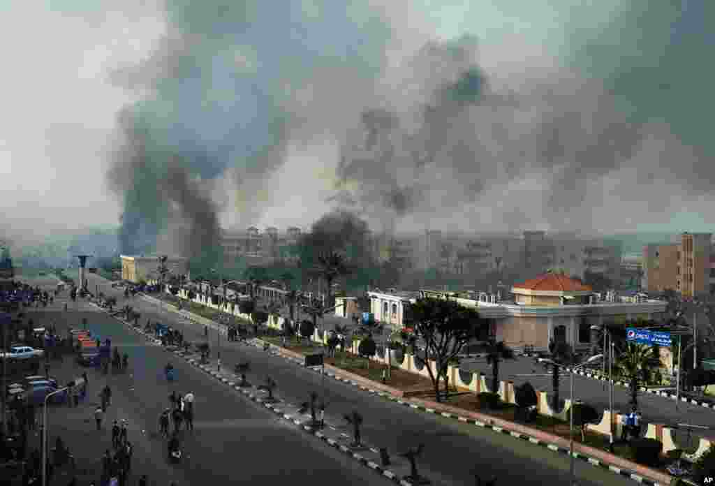 Smoke rises after Egyptian protesters clash with police, unseen, in Port Said, Egypt, January 27, 2013.