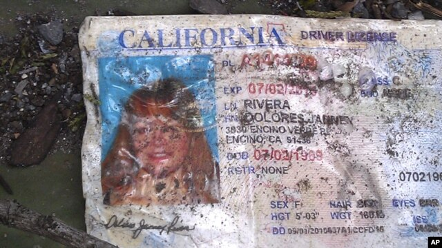A California driver's license bearing the name of Jenni Rivera sits on the ground at the site where a plane allegedly carrying Rivera crashed near Iturbide, Mexico, December 9, 2012.