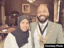 Magid Magid, left, a former refugee who has taken over as Sheffield's Lord Mayor, stands with Kaltum Osman, a Somali-born city councilor, after his inauguration. (Photo courtesy of the office of Magid Magid)