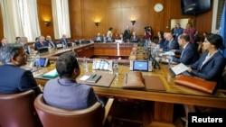 FILE - Iran's Deputy Foreign Minister Hossein Jaberi Ansari, Russian envoy Alexander Lavrentiev, Turkish Deputy Foreign Minister Sedat Onal and U.N. envoy Staffan de Mistura attend a meeting on Syria at European U.N. headquarters in Geneva, Sept. 11, 2018.