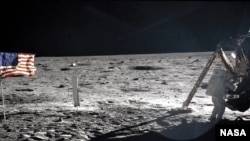 "Neil Armstrong getting equipment form the Lunar Module ""Eagle"" on the surface of the moon. The picture was taken by Buzz Aldrin."