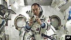 Expedition 23 Flight Engineer Soichi Noguchi, representing the Japan Aerospace Exploration Agency, tries on the Russian Sokol pressurized spacesuit he will wear when he rides the Soyuz TMA-17 spacecraft back to Earth, 31 May 2010