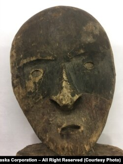 A wooden Chugach mask, one of the nine items returned to the Chugach people by the Prussian Cultural Heritage Foundation.