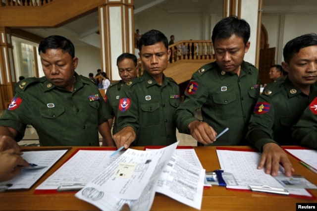 Myanmar's army members of the parliament arrive at the Union Parliament session in Naypyitaw, Jan. 28, 2016.