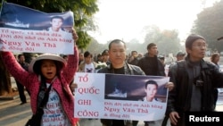 Anti-China protesters during a gathering to mark the 40th anniversary of a battle with China over the disputed Paracel Islands in Hanoi, January 19, 2014.