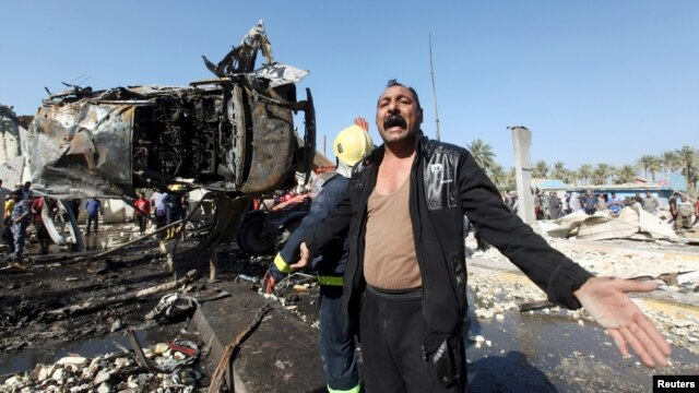 A man reacts at the site of a bomb attack at a checkpoint in the city of Hilla, south of Baghdad, Iraq, March 6, 2016.