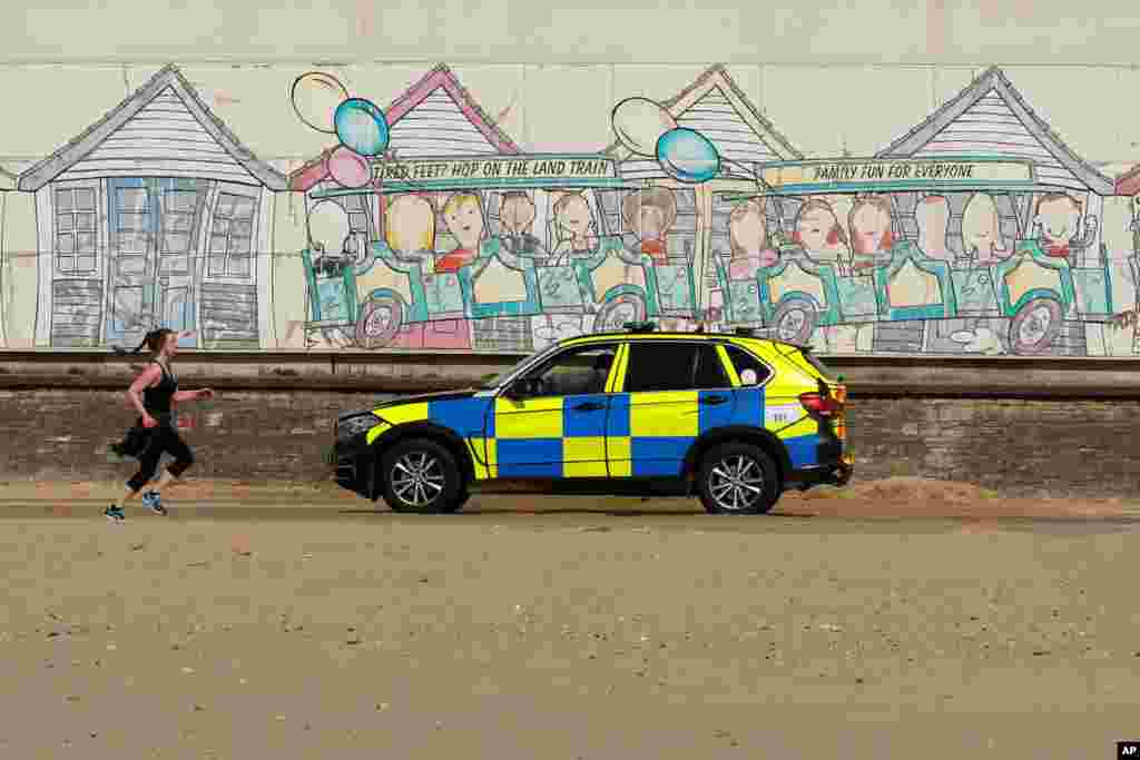 Police are seen on Bournemouth beach in Britain as the spread of the coronavirus disease (COVID-19) continue.