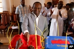 Former Prime Minister Anicet Georges Dologuele casts his ballot in the second round of presidential election and the first round of legislative elections in Bangui, Central African Republic, Feb. 14, 2016.